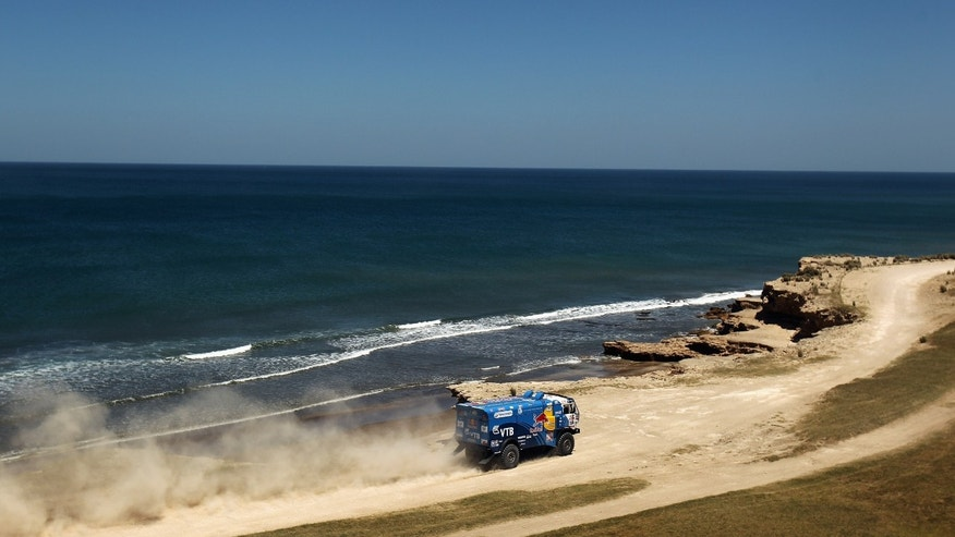 SANTA ROSA DE LA PAMPA, ARGENTINA - JANUARY 01:  Ayrat Mardeev of Russia drives his truck along the coast during stage one of the 2012 Dakar Rally from Mar Del Plata to Santa Rosa de la Pampa on January 1, 2012 in Santa Rosa de la Pampa, Argentina.  (Photo by Bryn Lennon/Getty Images)