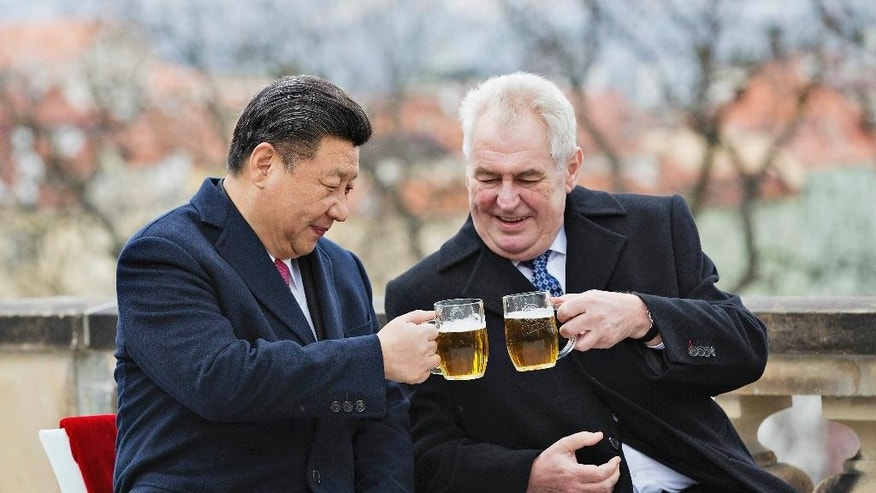 Chinese President Xi Jinping, left, and Czech Republic's President Milos Zeman, right, clink glasses of beer on the terrace of the Strahov Monastery in Prague, Czech Republic, Wednesday, March 30, 2016. Xi Jinping leaves Czech Republic this afternoon. (Rene Fluger/CTK via AP) SLOVAKIA OUT