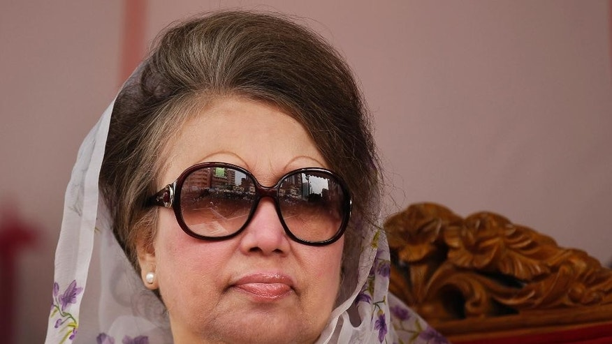 FILE-In this Jan. 5, 2016 file photo, Bangladesh's former prime minister and  Bangladesh Nationalist Party (BNP) leader Khaleda Zia, looks on at a protest rally to mark the second anniversary of a general election boycotted by a major opposition alliance in Dhaka, Bangladesh. A Bangladeshi court Wednesday, March 30, 2016 issued arrest warrants for former Prime Minister Khaleda Zia and 27 other opposition party leaders on accusations they instigated an arson attack on a passenger bus during an anti-government protest last year.(AP Photo/ A.M. Ahad, file)