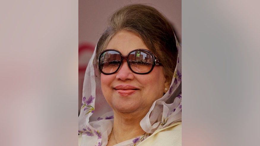 FILE-In this Jan. 5, 2016 file photo, Bangladesh's former prime minister and  Bangladesh Nationalist Party (BNP) leader Khaleda Zia, smiles at a protest rally to mark the second anniversary of a general election boycotted by a major opposition alliance in Dhaka, Bangladesh. A Bangladeshi court Wednesday, March 30, 2016 issued arrest warrants for former Prime Minister Khaleda Zia and 27 other opposition party leaders on accusations they instigated an arson attack on a passenger bus during an anti-government protest last year.(AP Photo/ A.M. Ahad, file)