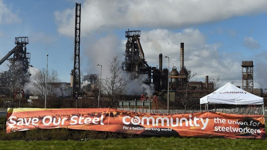 Banners supporting local steel workers are seen outside the Tata steel plant in Port Talbot, Wales, Wednesday  March 30, 2016. UK authorities say they will look at all viable options to keep the British steel industry at the heart of its manufacturing base after Tata Steel announced it may sell its UK assets. The sale could put thousands of jobs at risk. (Andrew Matthews/PA via AP)  UNITED KINGDOM OUT