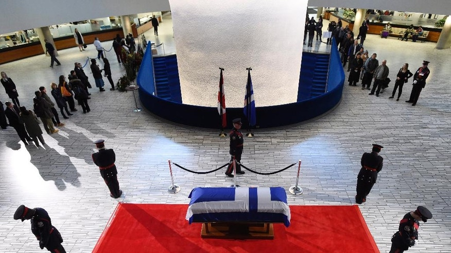 Former Toronto mayor Rob Ford's casket lies in repose at city hall on Tuesday, March 29, 2016 in Toronto. Ford died of cancer on March 22. (Frank Gunn/The Canadian Press via AP) MANDATORY CREDIT