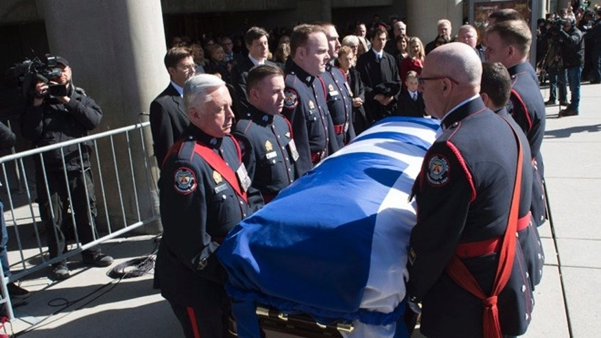 Pallbearers carry the casket of former Toronto mayor Rob Ford from city hall during his funeral procession to St. James Cathedral in Toronto on Wednesday.