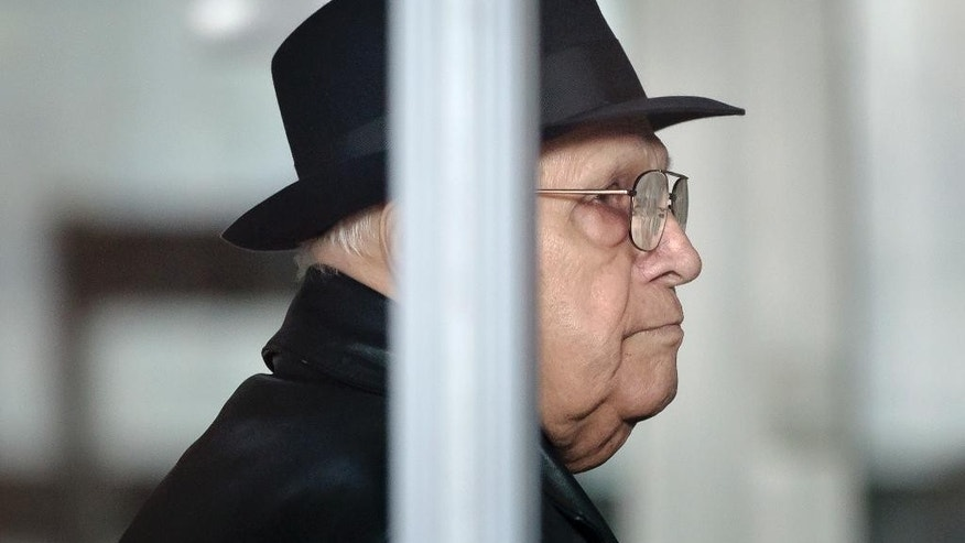FILE - In this Thursday, Oct. 24, 2013 file picture, Ion Ficior, former commander of a communist labor camp, waits for registration at the general prosecutors office in Bucharest, Romania. A Romanian court has sentenced Ficior, 87 years-old, Wednesday, March 30, 2016, to 20 years in prison, for the deaths of 103 political prisoners who perished while he was commander of the Periprava labor camp from 1958 to 1963. (AP Photo/Vadim Ghirda, File)