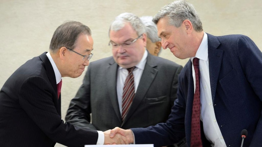 "United Nations Secretary General Ban Ki-moon, left, shakes hands with United Nations High Commissioner for Refugees, UNHCR, Italian Filippo Grandi, right, during a one-day conference meant to further efforts to resettle Syrian refugees at the United Nations in Geneva, Switzerland, Wednesday, March 30, 2016. Ban Ki-moon is urging governments around the globe to let in more people from Syria and ""counter fearmongering"" about refugees. (Martial Trezzini/Keystone via AP)"