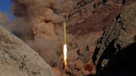 """In this photo obtained from the Iranian Fars News Agency, a Qadr H long-range ballistic surface-to-surface missile is fired by Iran's powerful Revolutionary Guard, during a maneuver, in an undisclosed location in Iran, Wednesday, March 9, 2016. Iran's powerful Revolutionary Guard test-fired two ballistic missiles Wednesday with the phrase """"Israel must be wiped out"""" written on them, a show of deterrence power by the Islamic Republic as U.S. Vice President Joe Biden visited Israel, the semi-official Fars news agency reported. (AP Photo/Fars News Agency, Omid Vahabzadeh)"""