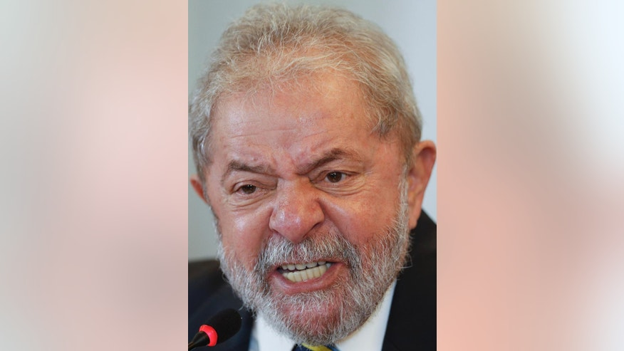 Brazil's former President Luiz Inacio Lula da Silva gives a news conference in Sao Paulo, Brazil, Monday, March 28, 2016. Lula da Silva said he believes his embattled successor and protege can survive mounting pressure in Congress for her impeachment. (AP Photo/Andre Penner)