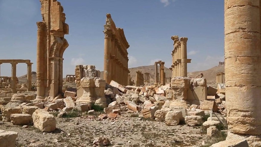 This photo released on Monday March 28, 2016, by the Syrian official news agency SANA, shows some damage at the ancient ruins of Palmyra, central Syria. A Syrian antiquities official says demining experts have so far removed 150 bombs planted by the Islamic State group inside the archaeological site in the historic town of Palmyra. Syrian troops captured the town from IS fighters on Sunday after three weeks of intense fighting.(SANA via AP)