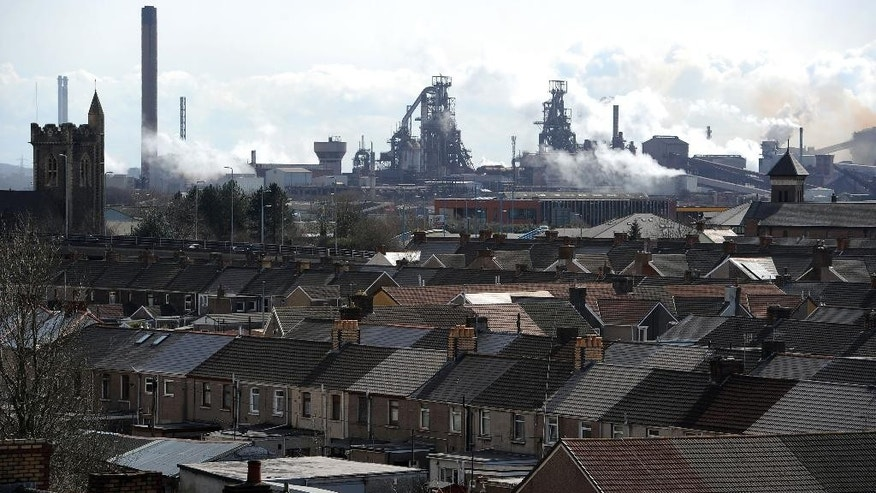 The Tata steel plant  dominates the skyline over the roof tops of Port Talbot, Wales, Wednesday March 30, 2016. UK authorities say they will look at all viable options to keep the British steel industry at the heart of its manufacturing base after Tata Steel announced it may sell its UK assets. The sale could put thousands of jobs at risk.  (Andrew Matthews/PA via AP) UNITED KINGDOM OUT