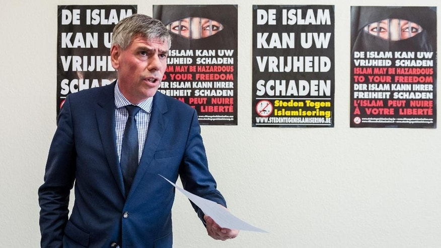 "Far right Flemish Interest leader Filip Dewinter addresses the media on his party's proposals to fight terrorism, at the Belgian federal parliament in Brussels, Tuesday, March 29, 2016. The posters on the back read in Dutch: ""Islam can harm your freedom"". (AP Photo/Geert Vanden Wijngaert)"