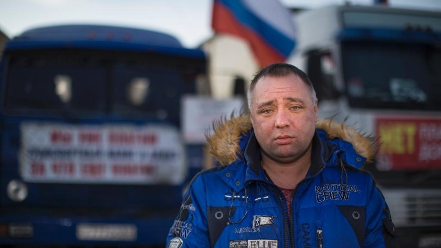 In this photo taken on Thursday, March  10, 2016, Andrei Bazhutin, a long-haul truck driver, speaks to The Associated Press, in Moscow, Russia. Over the years, corruption has permeated every layer of Russian society with bribes priced into the price of goods and services. (AP Photo/Alexander Zemlianichenko)