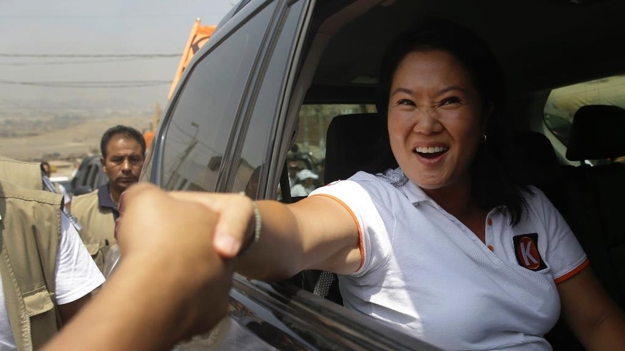 "Presidential candidate Keiko Fujimori, of the ""Fuerza Popular"" political party, greets supporters as she campaigns in the Cajamarquilla shantytown on the outskirts of Lima, Peru, Wednesday, March 30, 2016. Keiko, the daughter of former President Alberto Fujimori, is running for president in Peru's April 10 election. (AP Photo/Martin Mejia)"