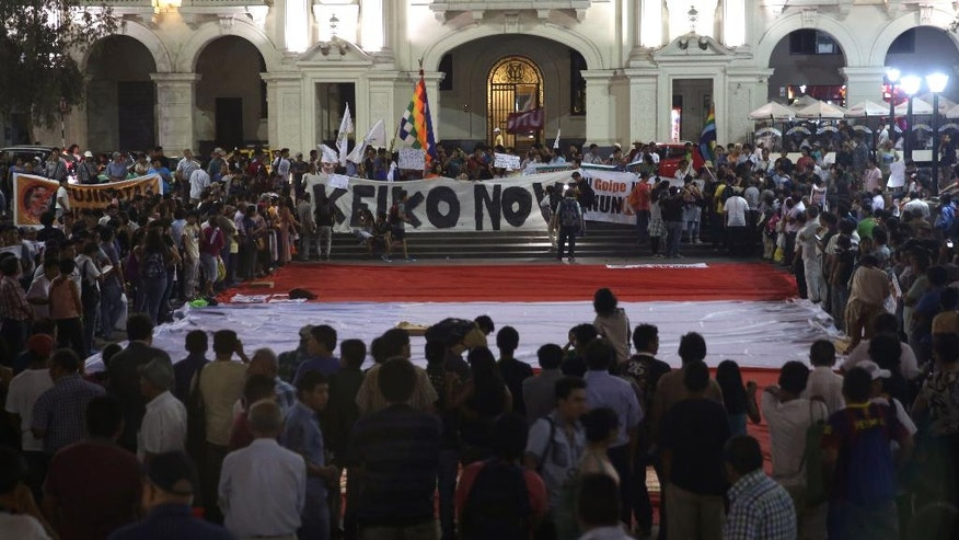 "Demonstrators protest the presidential candidacy of Keiko Fujimori with a big poster that reads in Spanish: ""No to Keiko"" in Plaza San Martin in downtown Lima, Peru, Wednesday, March 30, 2016. Keiko, the daughter of former President Alberto Fujimori, is running for president in Peru's April 10 election. (AP Photo/Martin Mejia)"