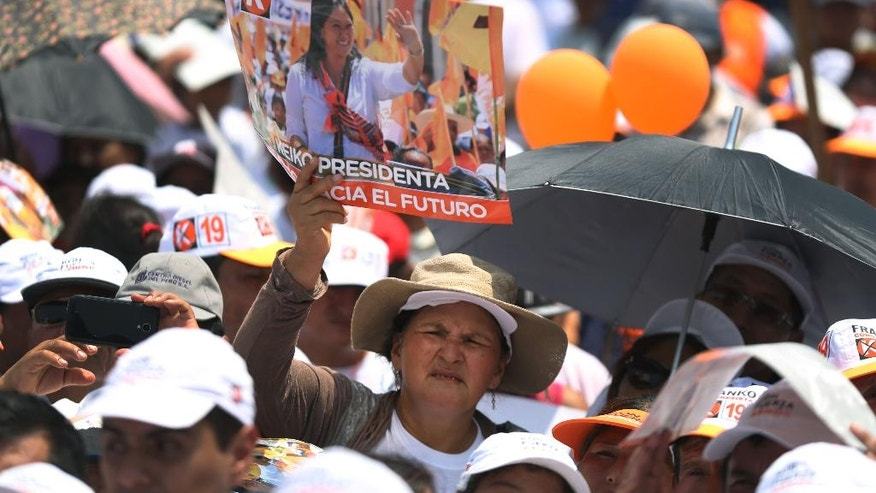 "A supporter of presidential candidate Keiko Fujimori, of the ""Fuerza Popular"" political party, attends a rally as she campaigns in the Cajamarquilla shantytown on the outskirts of Lima, Peru, Wednesday, March 30, 2016. Keiko, the daughter of former President Alberto Fujimori, is running for president in Peru's April 10 election. (AP Photo/Martin Mejia)"