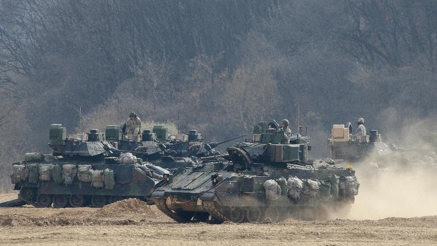 U.S. Army's armored vehicle moves during the annual exercise in Paju, near the border with North Korea, Friday, April 1, 2016. North Korea fired a short-range missile into the sea on Friday, Seoul officials said, hours after the U.S., South Korean and Japanese leaders pledged to work closer together to prevent North Korea from advancing its nuclear and missile programs. (AP Photo/Ahn Young-joon)