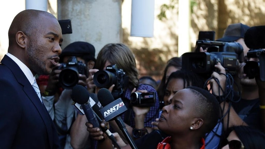"""Mmusi Maimane, leader of the Official opposition Democratic Alliance party, addresses journalist outside the Constitutional Court in Johannesburg, South Africa, Thursday, March 31, 2016. The court ruled that President Jacob Zuma """"failed to uphold"""" the law when he did not pay back some state funds used to upgrade his personal residence. (AP Photo/Themba Hadebe)"""