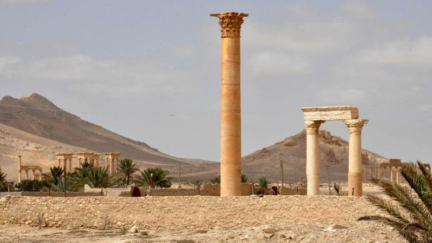 This photo released on Sunday March 27, 2016, by the Syrian official news agency SANA, shows a general view of Palmyra, central Syria. Palmyra is an archaeological gem that Syrian troops took back from Islamic State fighters in central Syria. The amount of destruction found inside the archaeological area in the historic Syrian town of Palmyra was similar to what experts have expected but the shock came Monday from inside the local museum where the extremists have caused wide damage demolishing invaluable statues that were torn to pieces. (SANA via AP)