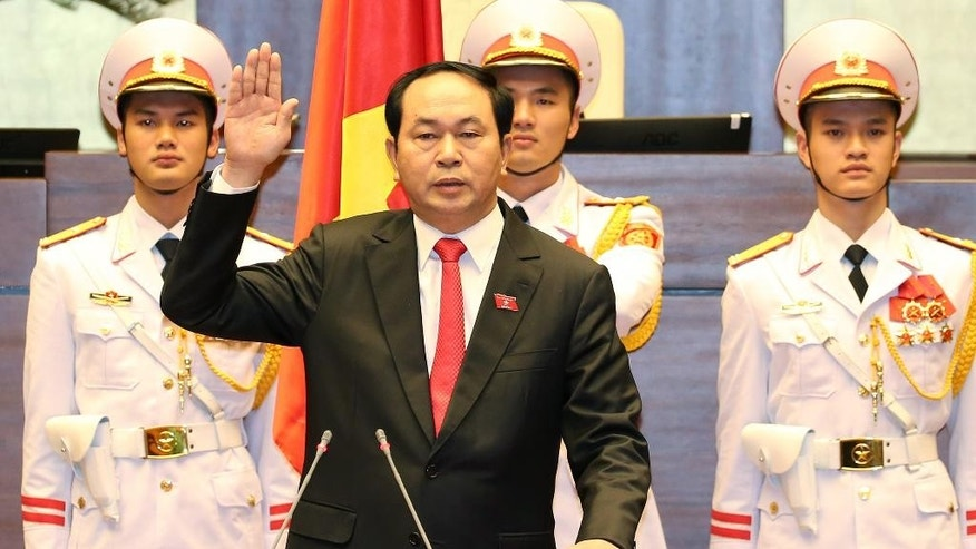 New Vietnamese President Tran Dai Quang takes the oath of office after being elected as the head of state in Hanoi, Vietnam, Saturday, April 2, 2016. Vietnam's National Assembly has elected Public Security Minister Quang, 59, to be the country's new president, the second-highest post in the country. (Thong Nhat/Vietnam News Agency via AP) VIETNAM OUT, MANDATORY CREDIT