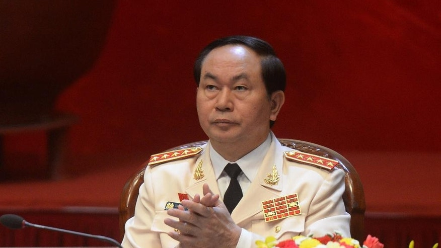 FILE - In this Jan. 21, 2016 file photo, Vietnam's Public Security Minister Gen. Tran Dai Quang applauds during the opening ceremony of the Communist Party of Vietnam's 12th Congress in Hanoi, Vietnam. Vietnam's National Assembly has elected the police chief to be the country's new president, the second-highest post in the country. Quang, 59, took the oath of office Saturday, April 2 after the vote. (Hoang Dinh Nam/Pool Photo via AP, File)