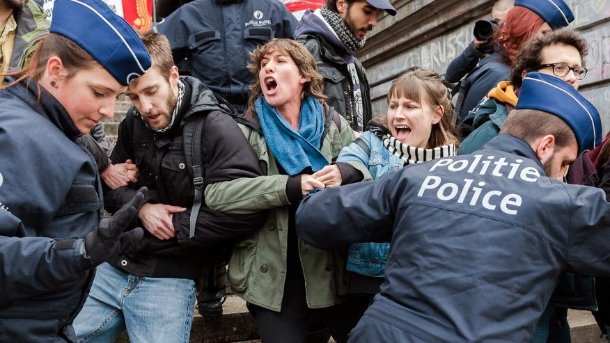 Police detain a group of people at the Place de la Bourse in Brussels, Belgium, Saturday, April 2, 2016. Authorities had banned all marches in Brussels, after a far-right group announced its plans to hold an anti-Muslim rally in the city. (AP Photo/Geert Vanden Wijngaert)