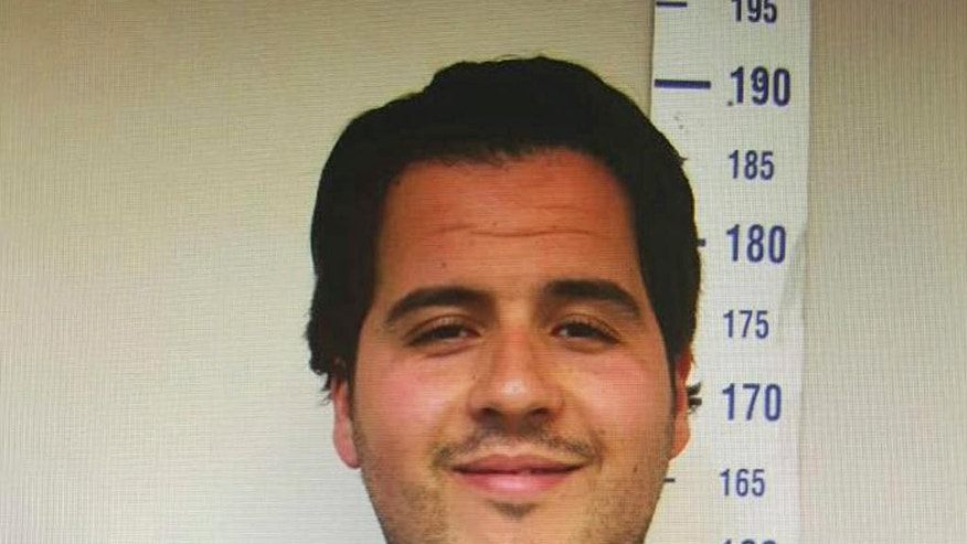 FILE - In this file image originally made available Thursday, March 24, 2016, by Haberturk newspaper, showing Ibrahim El Bakraoui pictured in July 2015 by Gaziantep police.  When Ibrahim El Bakraoui blew himself up in the Brussels airport check-in area, killing and maiming scores of travelers, it was at least the third time he had passed unimpeded through an airport terminal in recent months. But according to reports Saturday April 2, 2016, including testimony from government ministers, extracts of documents and conversations with police, as well as border and aviation officials, a series of security gaps, misunderstandings and procedural red-tape allowed Bakraoui to travel unimpeded, and he may be just one case among many. (Haberturk newspaper via AP, FILE)