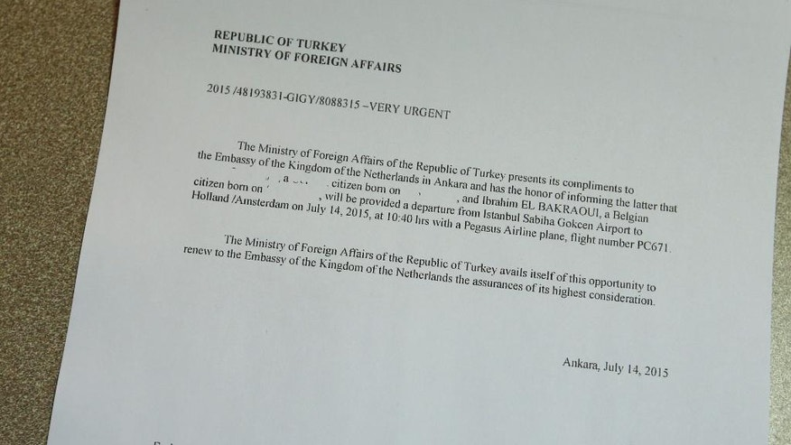 "This copy of a document released to the Associated Press by the Netherlands Government and photographed Wednesday, March 30, 2016 in Brussels, shows the notice given to the Dutch government by the Turkish Ministry of Foreign Affair, giving notice of the return of two people on an air flight back to Amsterdam on July 14, 2015. When Ibrahim El Bakraoui blew himself up in the Brussels airport check-in area on Tuesday, March 22, 2016, killing and maiming scores of travelers, it was at least the third time he had passed unimpeded through an airport terminal in recent months. Suspected by Turkey of being a ""foreign terrorist fighter"" and a known ex-con who was wanted for parole violations back home in Belgium, Bakraoui was nonetheless allowed to board a commercial airliner unaccompanied last summer, fly freely from Istanbul to the Netherlands and disappear without a trace.(AP Photo/Alastair Grant)"
