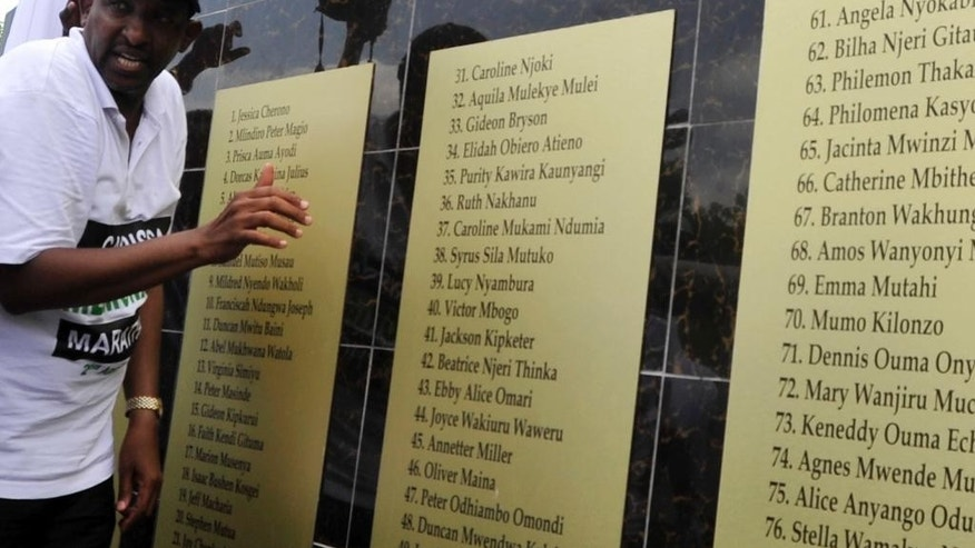 Adam Duale, leader of the majority in Kenyan Parliament, unveils the memorial plaque in memory of the students killed in the Garissa University attack, in Garissa, Kenya, Saturday, April 2, 2016. Kenya has marked the first anniversary of the Garissa University attack in which more than 148 people, most of them students, died at the hands of extremist gunmen. Hundreds gathered at the Garissa University in eastern Kenya on Saturday to remember the incident, one of the country's worst-ever terrorist attacks.(AP Photo/Kevin Midigo)