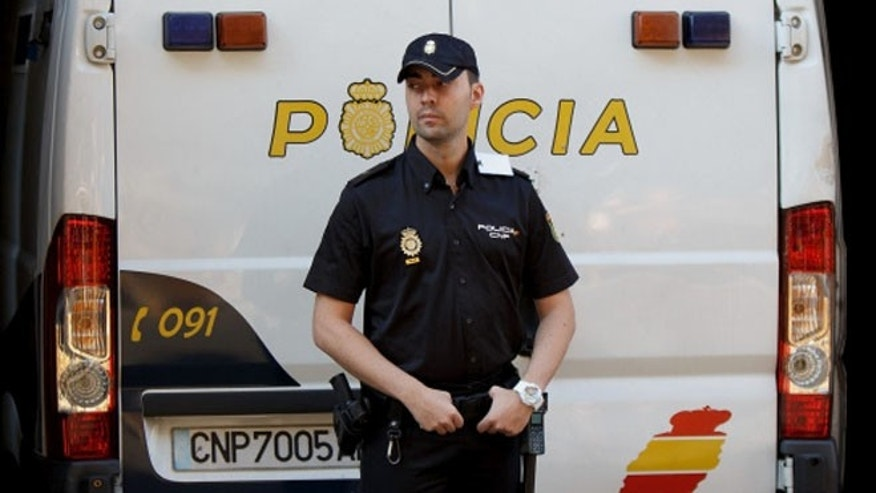 MADRID, SPAIN - SEPTEMBER 01:  A policeman stands guard as a police van allegedly holding Brett and Naghemeh King, parents of five years old Ashya King arrives at the National Court on September 1, 2014 in Madrid, Spain. Ashya King, who has a brain tumour, was taken by his parents from a UK hospital against medical advice resulting in the parents arrest in Velez, Malaga on Saturday on an extradition warrant by UK police authorities.  (Photo by Denis Doyle/Getty Images)