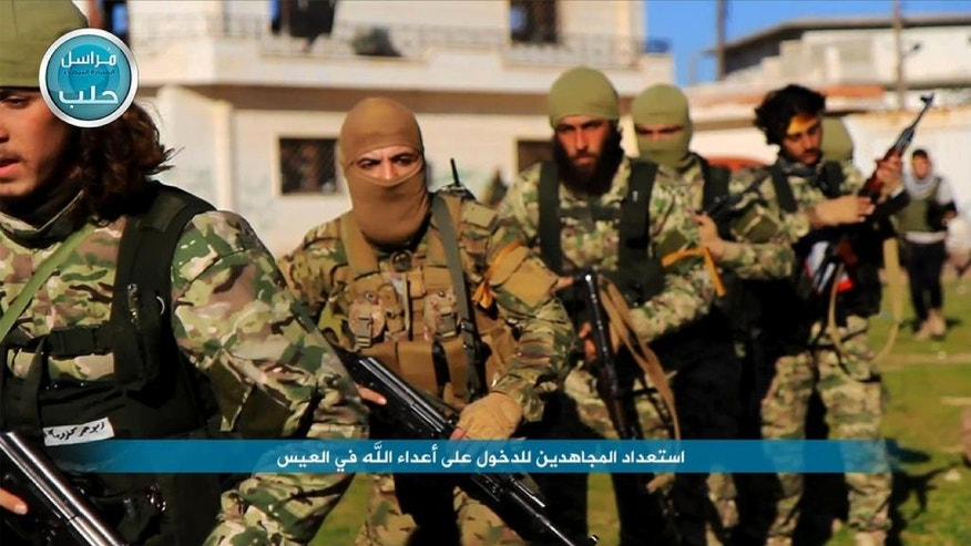 "In this image posted on the Twitter page of Syria's al-Qaida-linked Nusra Front on Friday, April 1, 2016, shows fighters from al-Qaida's branch in Syria, the Nusra Front, marching toward the northern village of al-Ais in Aleppo province, Syria. The Britain-based Syrian Observatory for Human Rights says 12 Hezbollah fighters were killed and dozens were wounded in Saturday's attack by militants led by al-Qaida's Syria branch — known as the Nusra Front — on the northern village of al-Ais. The title in Arabic that reads ""holy warriors getting ready to attack the enemies of God in al-Ais."" (Al-Nusra Front via AP)"