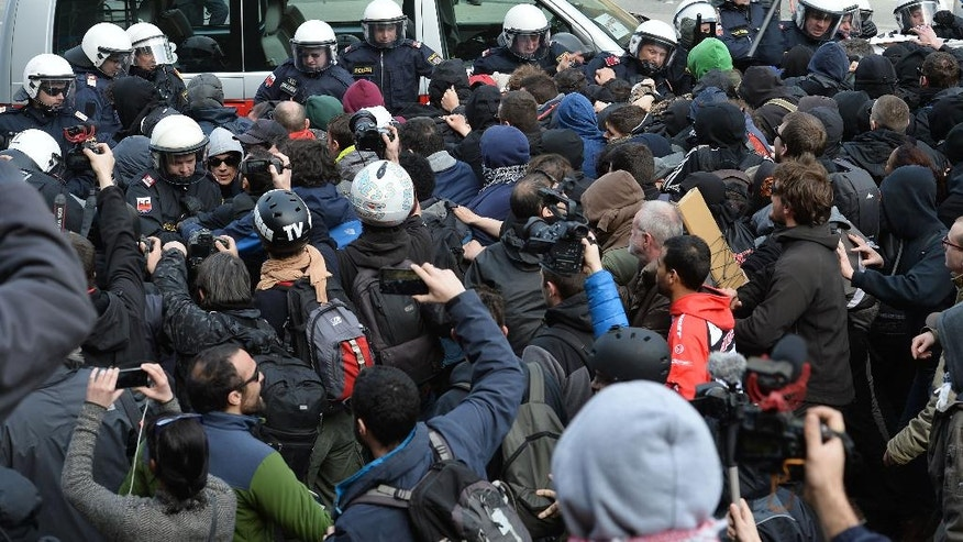 "Police  try to stopp protesters who demonstrate against new borders, on their way in the Italian village of Brenner on the Italian-Austrian border, Sunday, April 3, 2016.  Austria's defense minister said his country will deploy soldiers at a key Alpine pass to stop migrants arriving from Italy. Hans Peter Doskozil told German daily Die Welt that the move anticipates a shift in migrant flows from the Turkey-Greece route to the central Mediterranean. In an interview published Saturday, the newspaper quotes Doskozil saying that the military can provide ""considerable support to border security"" at the Brenner pass.    ( AP Photo/Kerstin Joensson)"