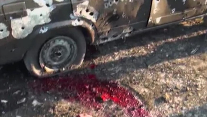 In this image from TV, a car lays destroyed with blood showing in the aftermath after heavy fighting erupted in Terter, Azerbaijan, Saturday April 2, 2016, between Armenian and Azerbaijani forces over the separatist region of Nagorno-Karabakh.  Russia expressed grave concern on Saturday over the recent military conflict along the Azerbaijan-Armenia border, calling on all parties involved to stop fighting and exercise restraint. Officials from each of the former Soviet republics blamed the other on Saturday for the fighting which began overnight. (Kanal S TV via AP) TV OUT