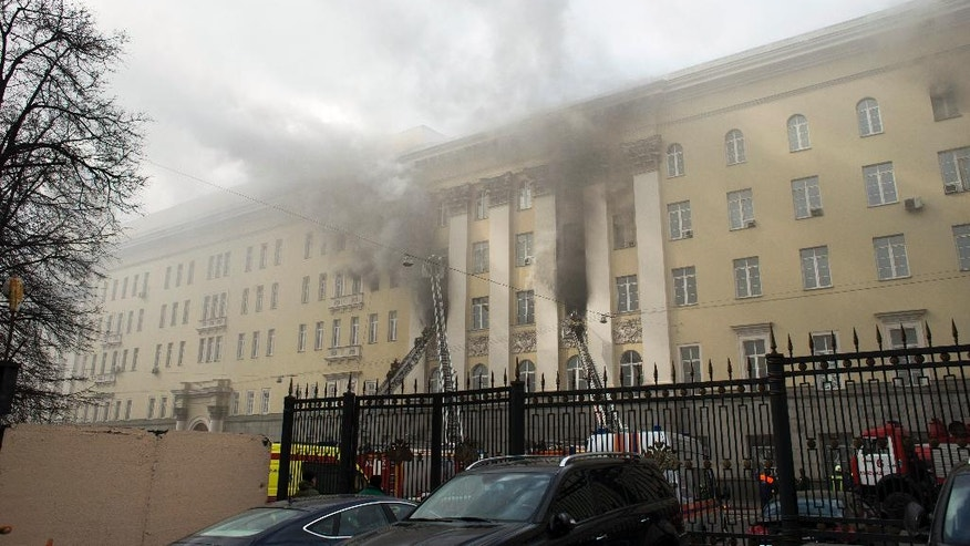 Firefighters work to put out a blaze at a building of Russian Defense Ministry in Moscow, Russia, Sunday, April 3, 2016. A building of the Russian Defense ministry is on fire in central Moscow with the fire brigade is on its way, the city's law enforcement bodies told Russian news agency TASS on Sunday. (AP Photo/Ivan Sekretarev)