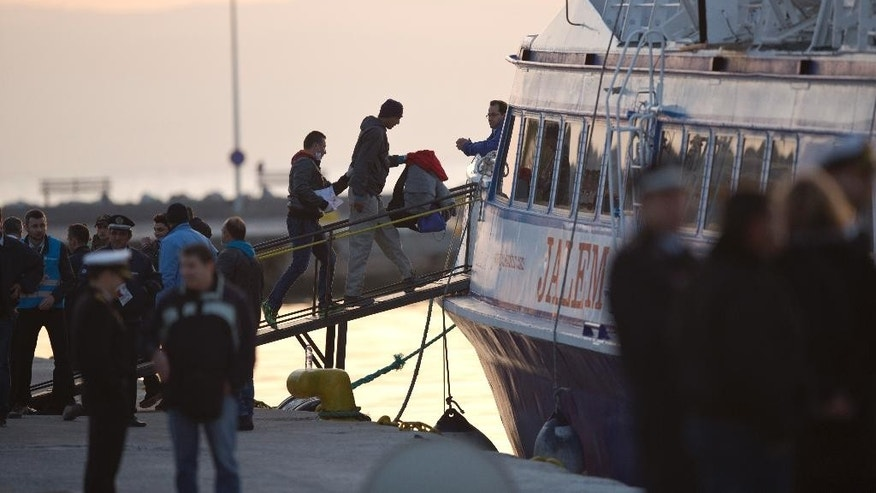 A migrant gets on a ferry for Turkey at the port of Mytilini in the Greek island of Lesbos, Monday, April 4, 2016, during the first day of the  implementation of the deal between EU and Turkey. Under the deal, migrants arriving illegally in Greece will be returned to Turkey if they do not apply for asylum or if they make an asylum claim that is rejected.(AP Photo/Petros Giannakouris)