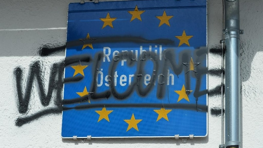 """Welcome"" is painted to the Austrian Border sign after protests  in the village of Brenner on the Italian-Austrian border, Sunday, April 3, 2016.  Austria's defense minister said his country will deploy soldiers at a key Alpine pass to stop migrants arriving from Italy. Hans Peter Doskozil told German daily Die Welt that the move anticipates a shift in migrant flows from the Turkey-Greece route to the central Mediterranean. In an interview published Saturday, the newspaper quotes Doskozil saying that the military can provide ""considerable support to border security"" at the Brenner pass.  (AP Photo/Kerstin Joensson)"