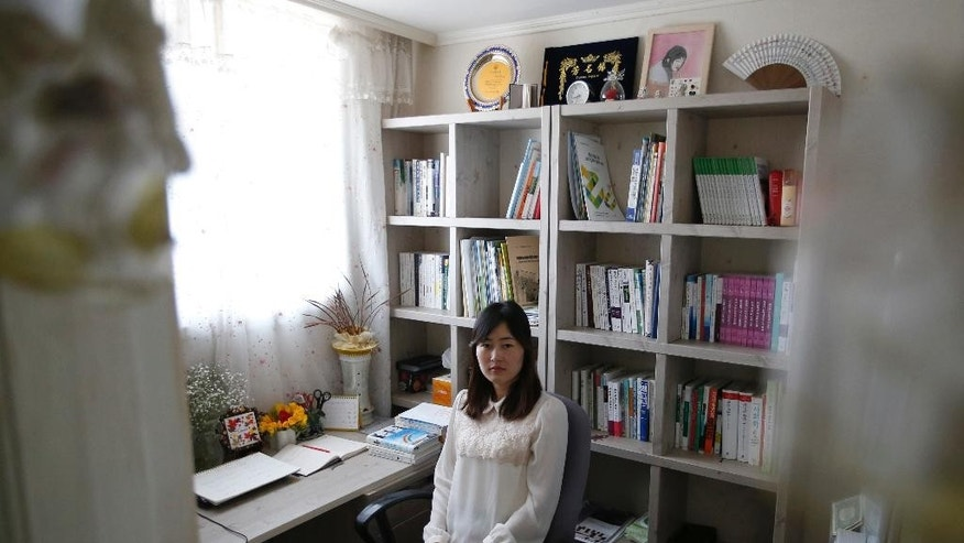 In this March 25, 2016 photo, exiled North Korean Gae-yoon Lee poses for a photo at her home in Seoul, South Korea. Lee, who was raised on a collective farm, left North Korea in 2010 with only a high school diploma. Six years later, she's a published poet who often writes about her childhood and the famine, and is midway through a degree in Korean literature at one of Seoul's top universities. (AP Photo/Lee Jin-man)
