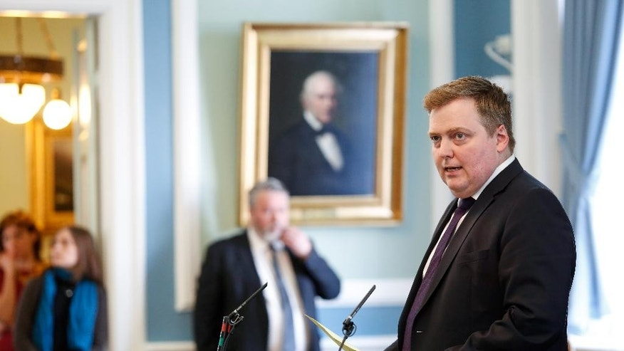 Iceland's Prime Minister Sigmundur David Gunnlaugsson, speaks during a parliamentary session in Reykjavik on Monday April 4, 2016. Iceland's prime minister insisted Monday he would not resign after documents leaked in a media investigation allegedly link him to an offshore company that would represent a serious conflict of interest, according to information leaked from a Panamanian law firm at the center of an international tax evasion scheme. (AP Photo/Brynjar Gunnarsson)