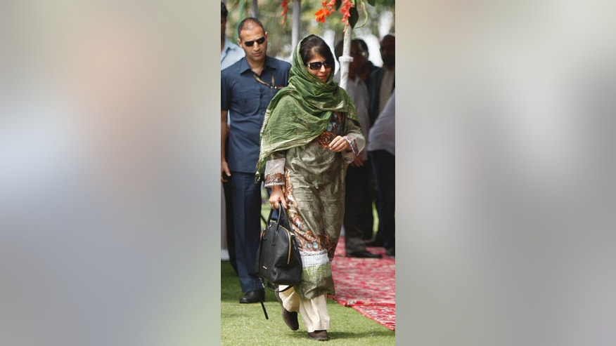 New Indian Kashmir Chief Minister Mehbooba Mufti walks to meet invitees after taking the oath of office during a ceremony in Jammu, India, Monday, April 4, 2016. Mufti, the leader of a pro-India party, on Monday became the first woman to become the chief minister of Indian Kashmir following the death of her father, the region's top elected leader. Mufti took the oath on Monday after her Peoples' Democratic Party and India's ruling Bharatiya Janata Party ended a nearly three-month deadlock over forming the state government. (AP Photo/Channi Anand)