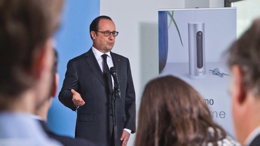 "French President Franocis Hollande, delivers a speech as he visits a tech company in Boulogne-Billancourt, outside Paris, Monday, April 4, 2016. French president says the Panama revelations are ""good news"" because it will help the state to recover money from people who have committed tax evasion. (AP Photo/Michel Euler, Pool)"
