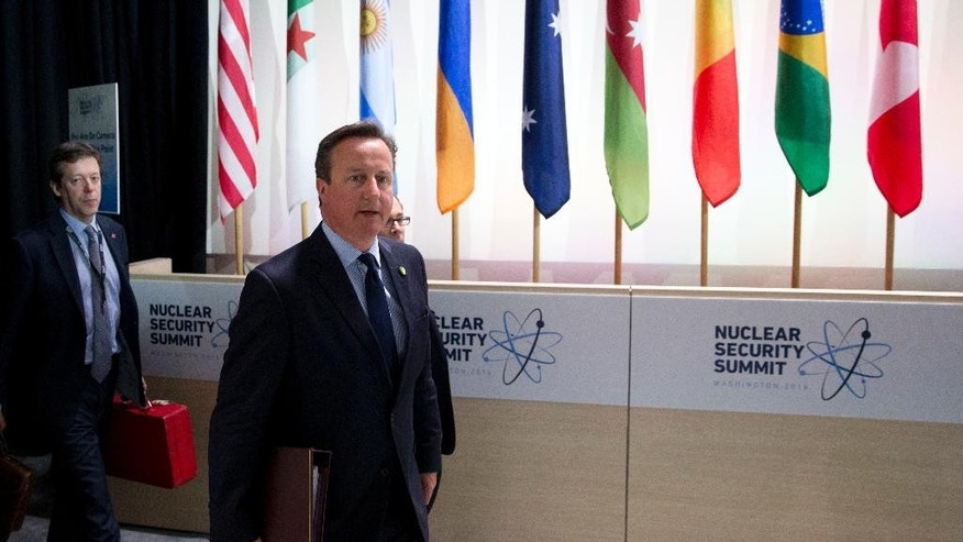 British Prime Minister David Cameron, right, arrives for the afternoon plenary session of the Nuclear Security Summit, Friday, April 1, 2016 in Washington. (AP Photo/Alex Brandon)