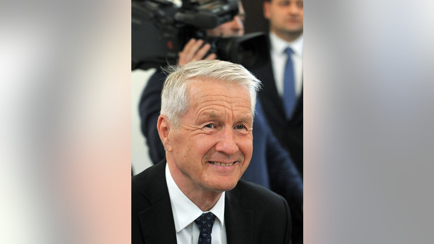 Secretary General of the Council of Europe Thornbjorn Jagland smiles prior to talks with Polish Prime Minister Beata Szydlo in Warsaw, Poland, Monday, April 4, 2016. Jagland came for talks with the country's leaders amid concerns over rule of law in Poland. (AP Photo/Alik Keplicz)