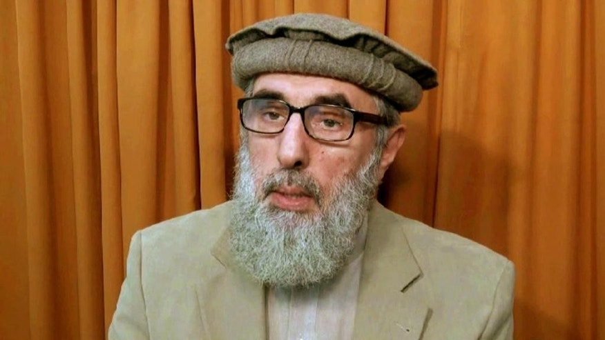 This image made from video released to the Associated Press during the week of Nov.  21, 2015 shows Afghan warlord Gulbuddin Hekmatyar, now in his late 60s, in an undisclosed location. A representative of a notorious Afghan warlord says he has dropped a key condition for ending his war on the Afghan state and wants a peace treaty with Kabul. (AP photo via AP video, File)