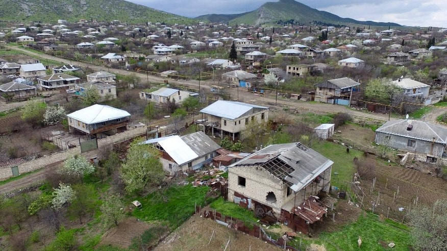This aerial view shows destroyed houses during the fighting at Martakert province in the separatist region of Nagorno-Karabakh, Azerbaijan, Monday, April 4, 2016. Fighting raged Monday around Nagorno-Karabakh, with Azerbaijan saying it lost three of its troops in the separatist region while inflicting heavy casualties on Armenian forces and the Armenian president warning that the hostilities could slide into a full-scale war. (Davit Abrahamyan, PAN Photo via AP)