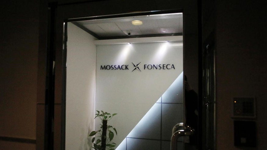 A pot plant is placed at the entrance of the regional head office of Panama-based law firm Mossack Fonseca, one of the world's biggest creators of shell companies, in Hong Kong, Tuesday, April 5, 2016. China's Internet censors and state media outlets squelched reports Tuesday on hidden wealth drawn from documents leaked from a Panama-based law firm that name relatives of current and retired Chinese politicians, including President Xi Jinping. (AP Photo/Vincent Yu)