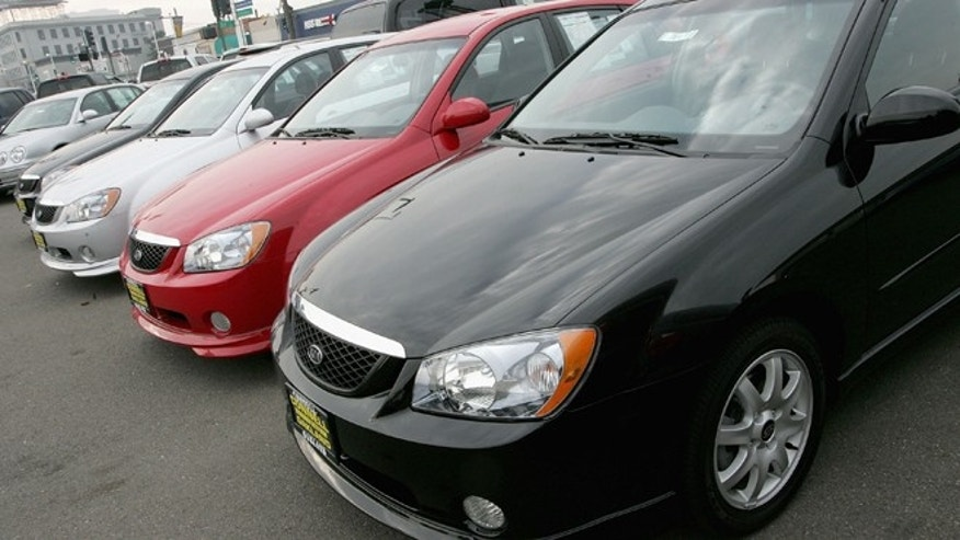 OAKLAND, CA - DECEMBER 20:  A row of 2005 KIA Spectras are seen on display at a KIA Dealership December 20, 2004 in Oakland, California. The Kia Spectra, a small, four-door sedan that starts at $13,240, received the insurance industry?s worst safety rating in a frontal crash test, the first vehicle to receive such a rating since the 2001 Chevrolet Cavalier. (Photo by Justin Sullivan/Getty Images)