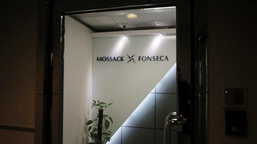A potted plant is placed at the entrance of the regional head office of Panama-based law firm Mossack Fonseca, one of the world's biggest creators of shell companies, in Hong Kong, Tuesday, April 5, 2016. China's Internet censors and state media outlets squelched reports Tuesday on hidden wealth drawn from documents leaked from a Panama-based law firm that name relatives of current and retired Chinese politicians, including President Xi Jinping. (AP Photo/Vincent Yu)