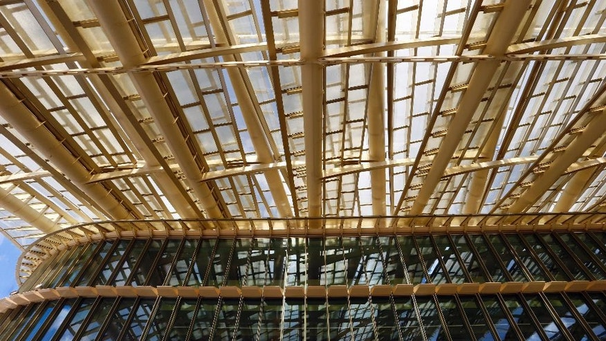 "A view of the Canopy, covering the new Les Halles shopping mall during the press visit Tuesday, April 5, 2016 in Paris, France. Paris' City Hall unveiled the long-awaited 1 billion euro revamp of the city's dilapidated main shopping and metro complex, ""Forum des Halles"" often the first port of call for tourists visiting the City of Light. The project has been called the ""canopy"" thanks to a eye-catching ondulating roof structure. (AP Photo/Francois Mori)"