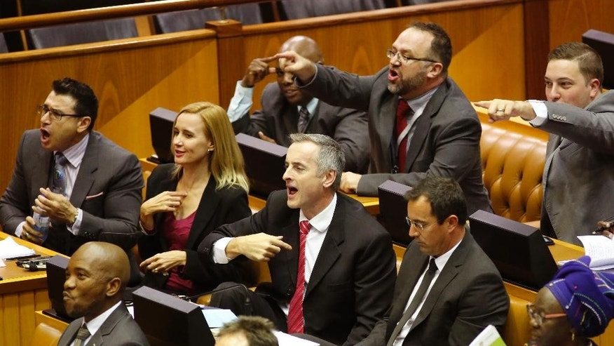 Mmusi Maimane, bottom left corner, leader of the official opposition party in South Africa, the Democratic Alliance party (DA), reacts with other party members as they complain against the Speaker Baleka Mbete, leading to a tempory suspension of the parliament session, in Cape Town, South Africa, Tuesday, April 5,  2016.  A South African parliamentary debate over whether to remove President Jacob Zuma was delayed Tuesday after opposition lawmakers alleged that the parliament speaker, a Zuma ally, could not preside over the session because of alleged partiality.  (AP Photo/Schalk van Zuydam)
