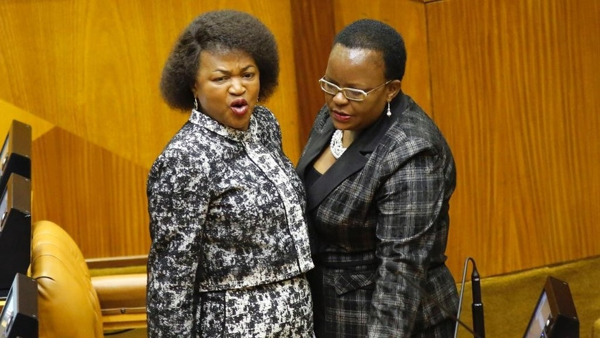 South Africa speaker of parliament  Baleka Mbete, left, after a temporarily suspension of a session in parliament Cape Town, South Africa, Tuesday, April 5,  2016. A South African parliamentary debate over whether to remove President Jacob Zuma was delayed Tuesday after opposition lawmakers alleged that the parliament speaker, a Zuma ally, could not preside over the session because she isn't impartial. (AP Photo/Schalk van Zuydam)