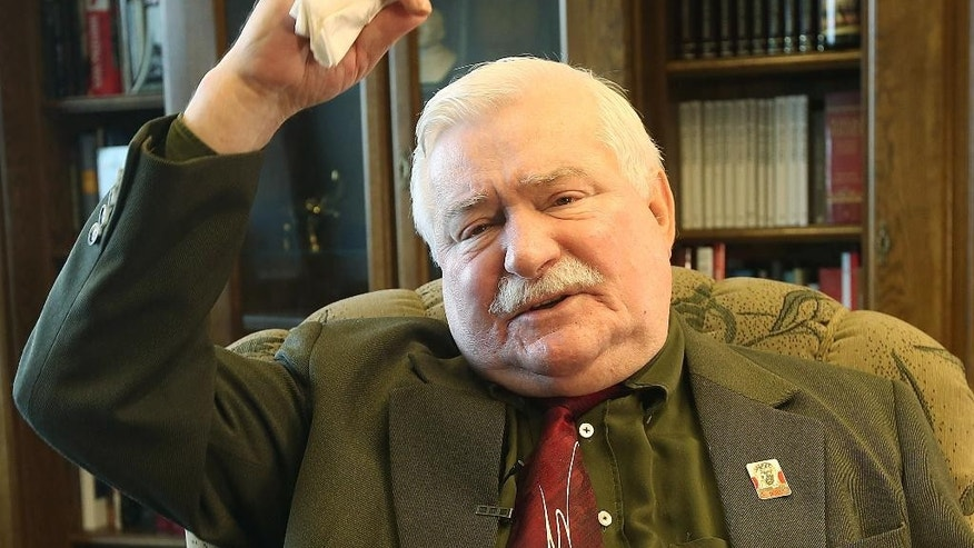 "Poland's former president and legendary Solidarity freedom movement founder Lech Walesa acts with expression as he repeats his denials to allegations he collaborated with the communist regime and talks about the ""crisis of democracy"" during an interview with The Associated Press at his new office at the European Solidarity Center in Gdansk, Poland, Wednesday, April 6, 2016. (AP Photo/Czarek Sokolowski)"