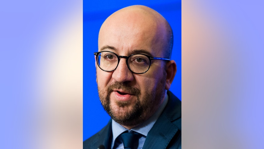 Belgium's Prime Minister Charles Michel addresses the media at the International Press Center in Brussels on Wednesday, April 6, 2016. Belgium's prime minister says life is returning to normal in Brussels two weeks after the suicide bombing attacks that killed 32 victims in the subway and at the airport.(AP Photo/Geert Vanden Wijngaert)